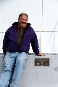 Wildcare's Shane Pinner & plaque Tasman Island lighthouse April 2015