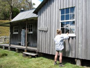 Kelly & Max painting windows frames, Mt Kate House (PD)