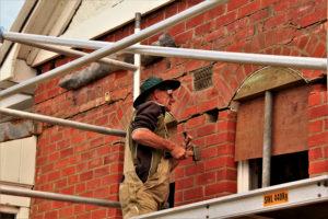 Vollunteer bricklayer repairs the fabric of Quarters No 3